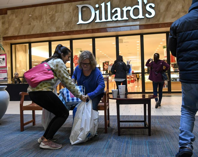 Hansley Jordan, left, of Hartwell, Georgia and Amy Payne of Hartwell get ready to go in Dillard's during Black Friday at the Anderson Mall in Anderson on Friday, November 23, 2018.