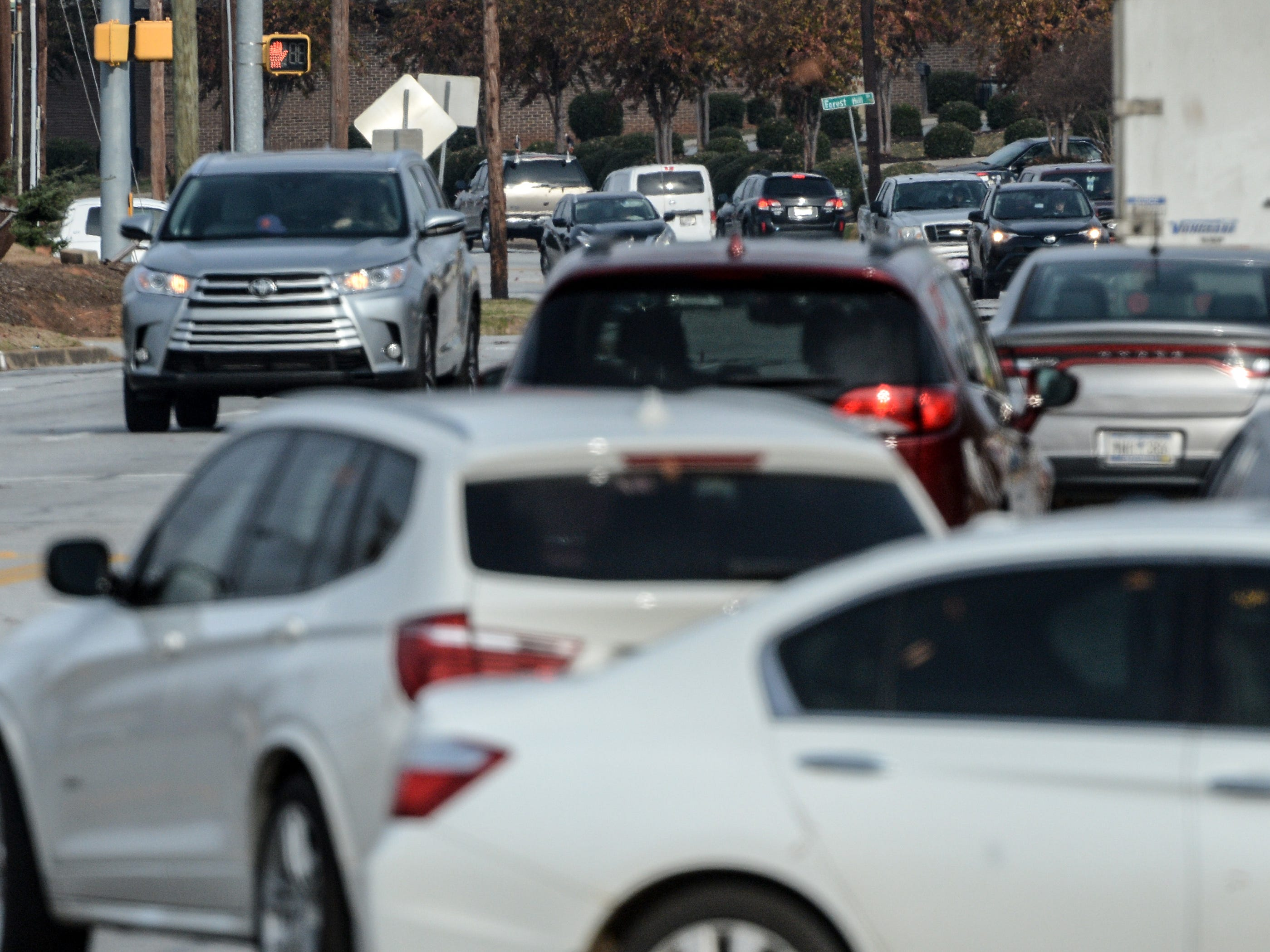 Traffic moves steadily on Clemson Boulevard during Black Friday in Anderson on Friday, November 23, 2018.