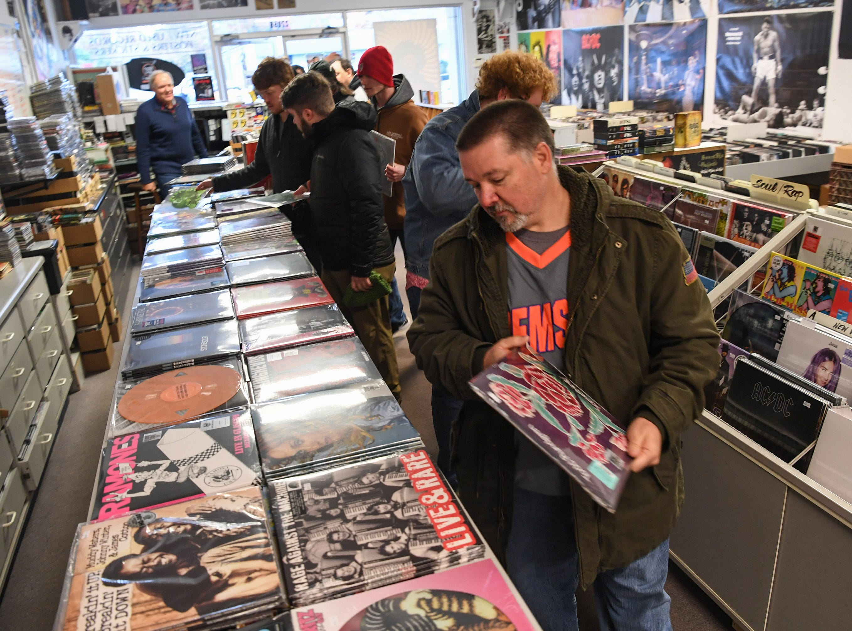 Robbie Grimes of Powdersville shops at Rainbow Records for Record Store Day deals on Black Friday in Anderson on Friday, November 23, 2018.