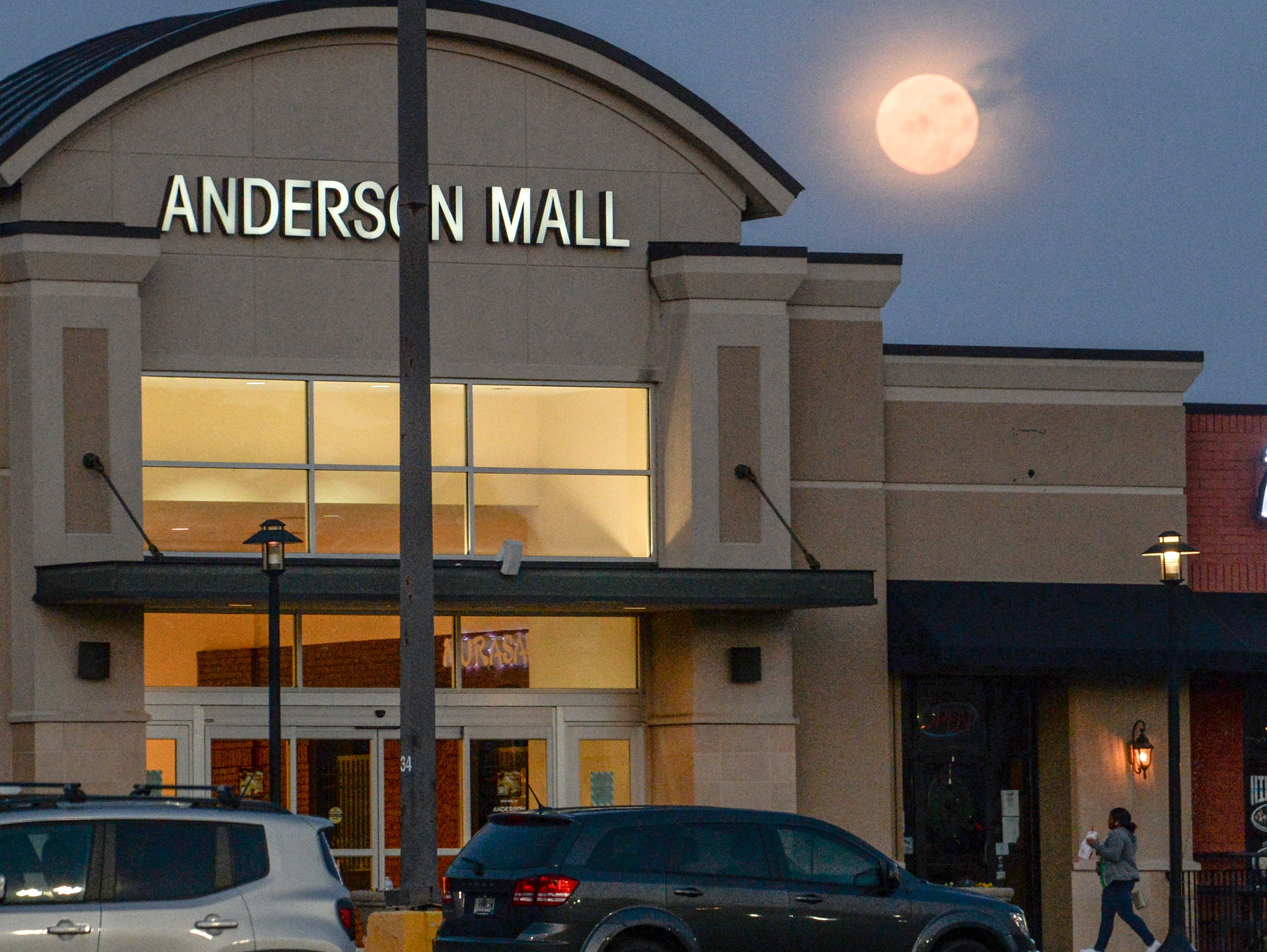 A full moon near the entrance of the Anderson Mall during Black Friday in Anderson on Friday, November 23, 2018.
