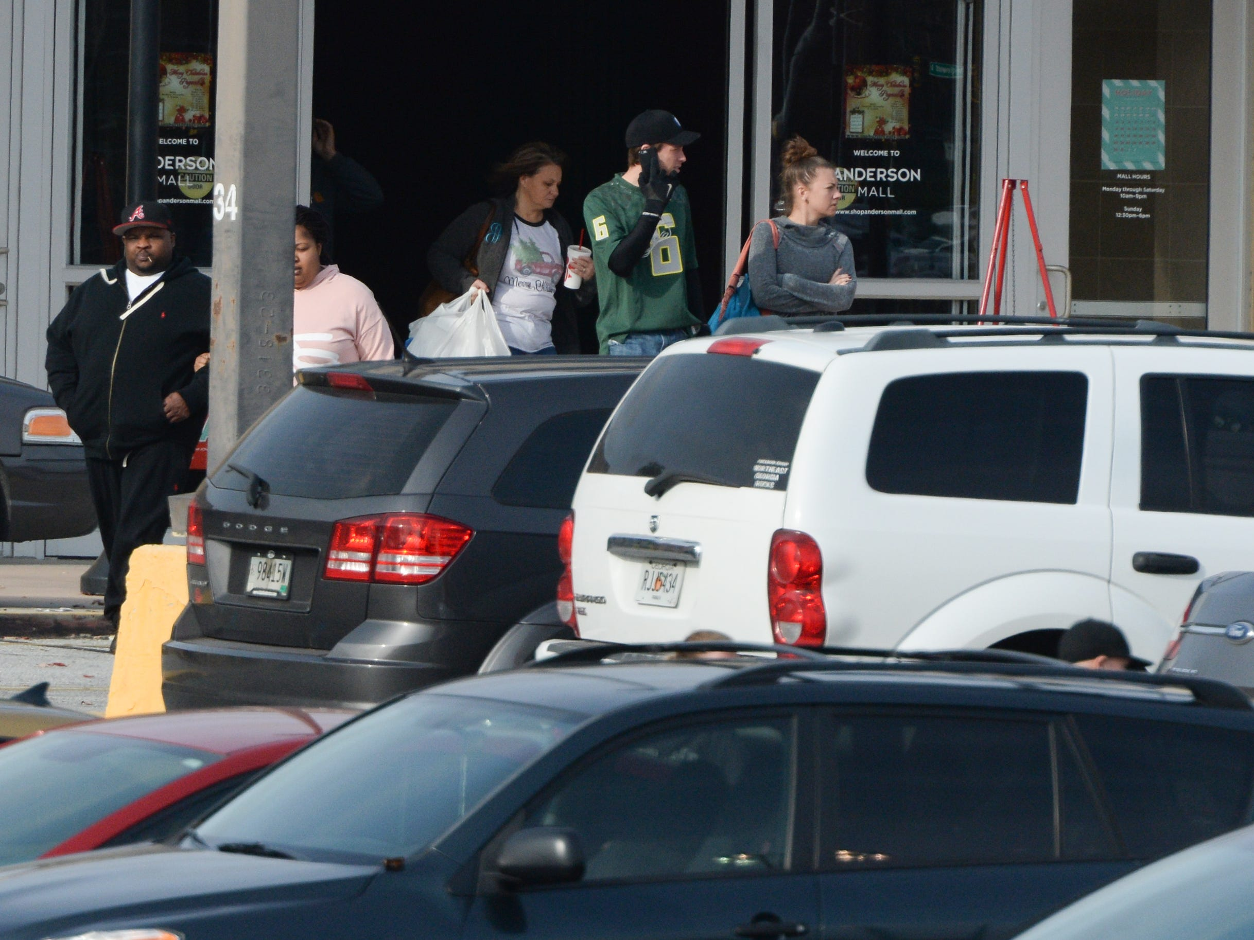 Customers go in and out of the Anderson Mall during Black Friday shopping on Friday, November 23, 2018.