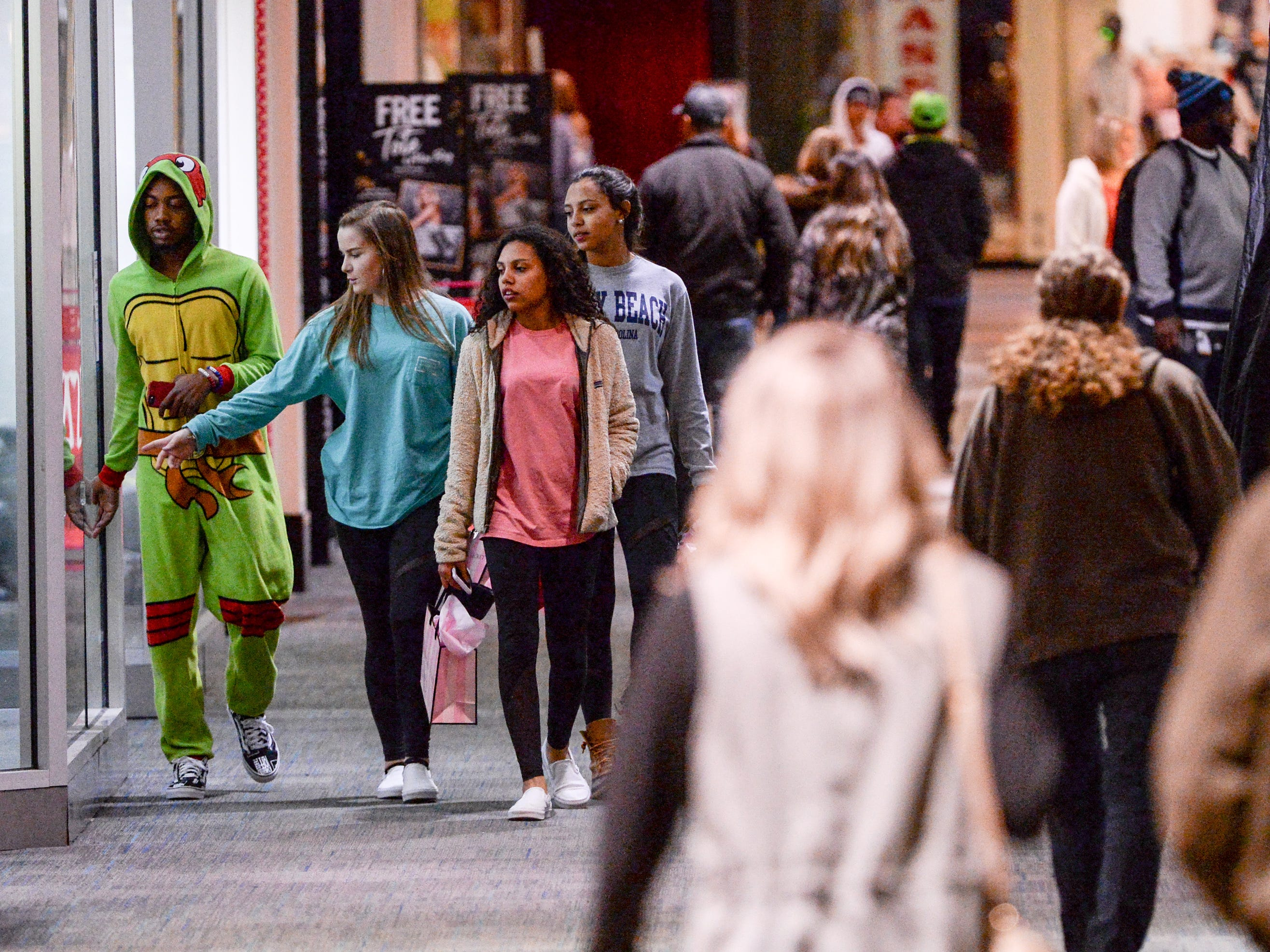 Customers walk by different stores in the Anderson Mall during Black Friday sales in Anderson on Friday, November 23, 2018.