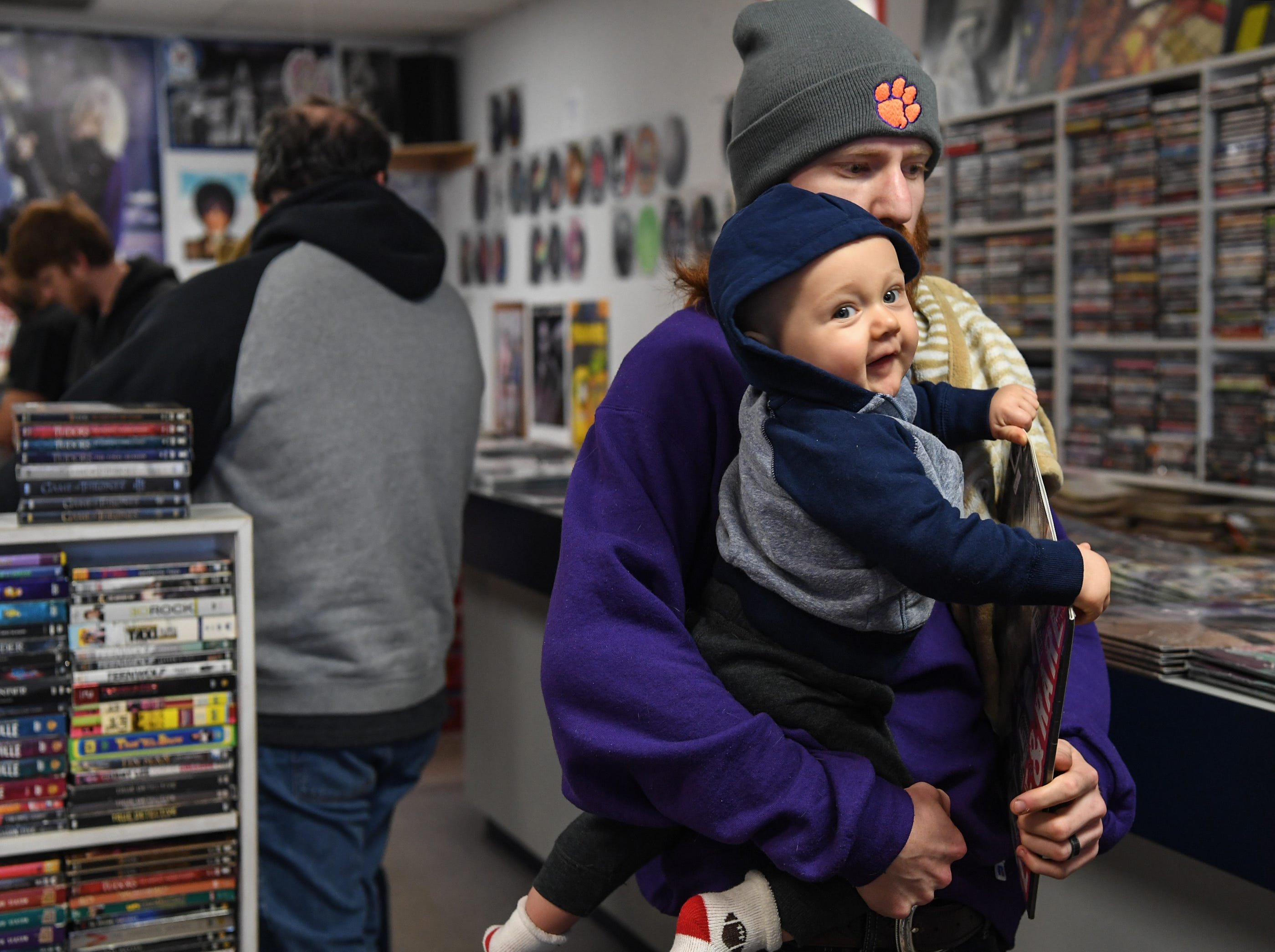 Jordan Maxwell and his son Jace of Pendleton shop at Rainbow Records for Record Store Day deals on Black Friday in Anderson on Friday, November 23, 2018.