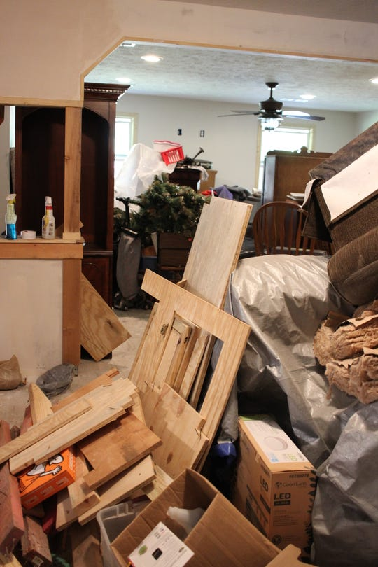 Construction debris and furniture mingle in what should be Pracilla Vinson's dining room. What began as a home improvement project turned into a nightmare that's cost her at least $100,000.