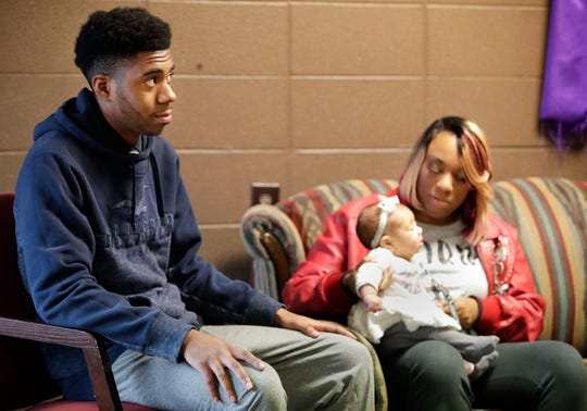Cedrick Taylor, 19, sits with his mother, Dorothy Brooks, before they spoke about their experiences with the Appleton Area School District's truancy court.