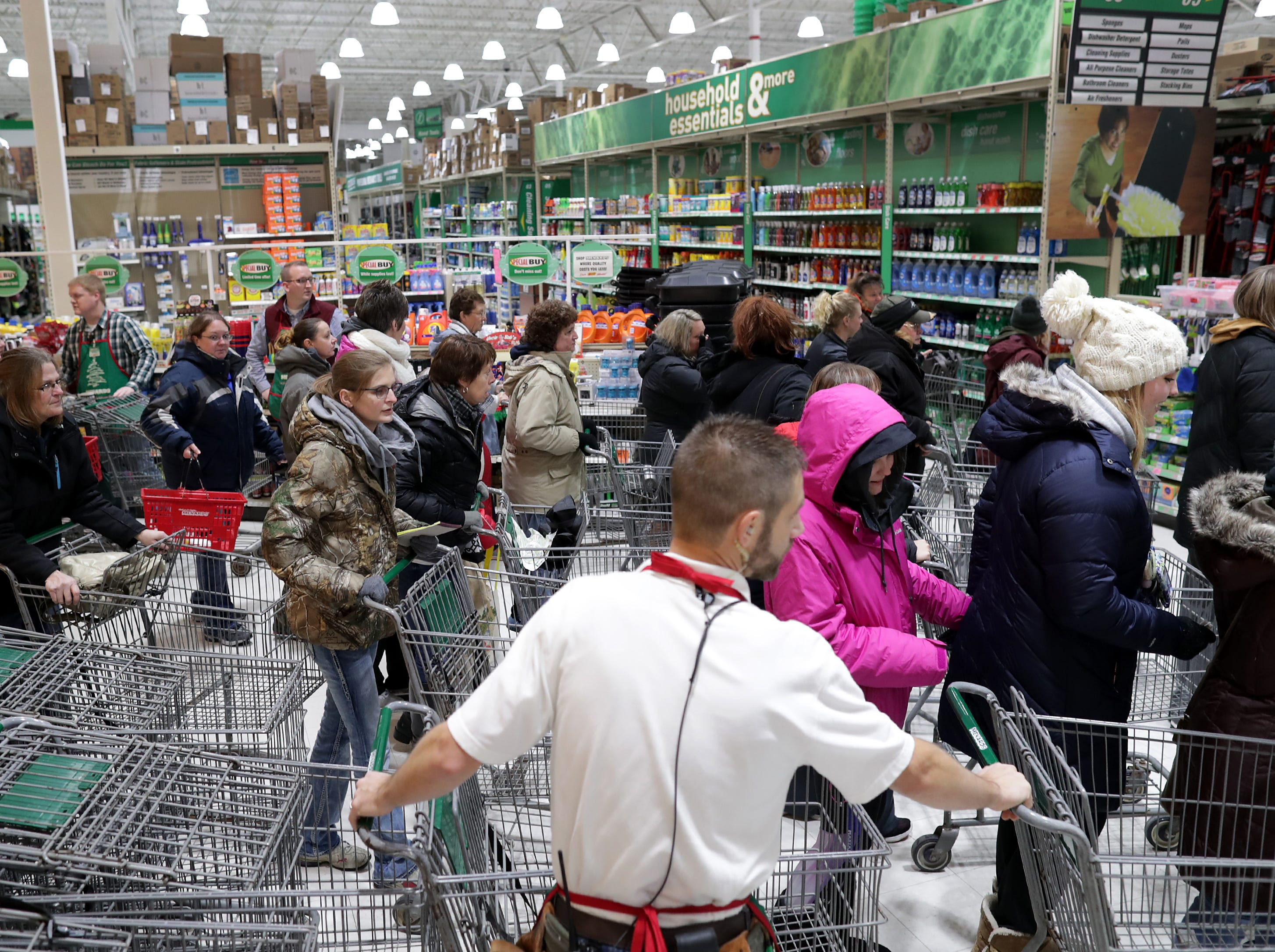 Shoppers looking for Black Friday deals stream through the doors at Menards on Friday, Nov. 23, 2018 in Grand Chute, Wis