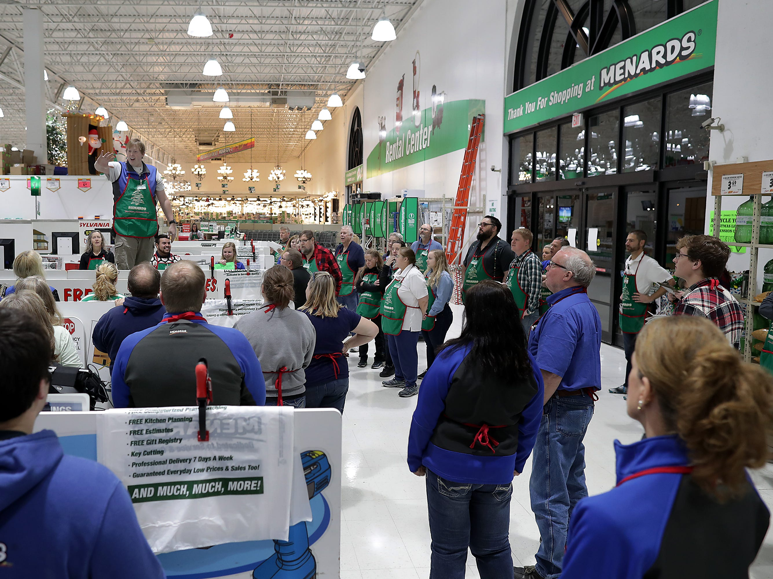 General Manager Tony Jacobson talks to the staff before opening the doors to Black Friday shoppers at Menards on Friday, Nov. 23, 2018 in Grand Chute, Wis