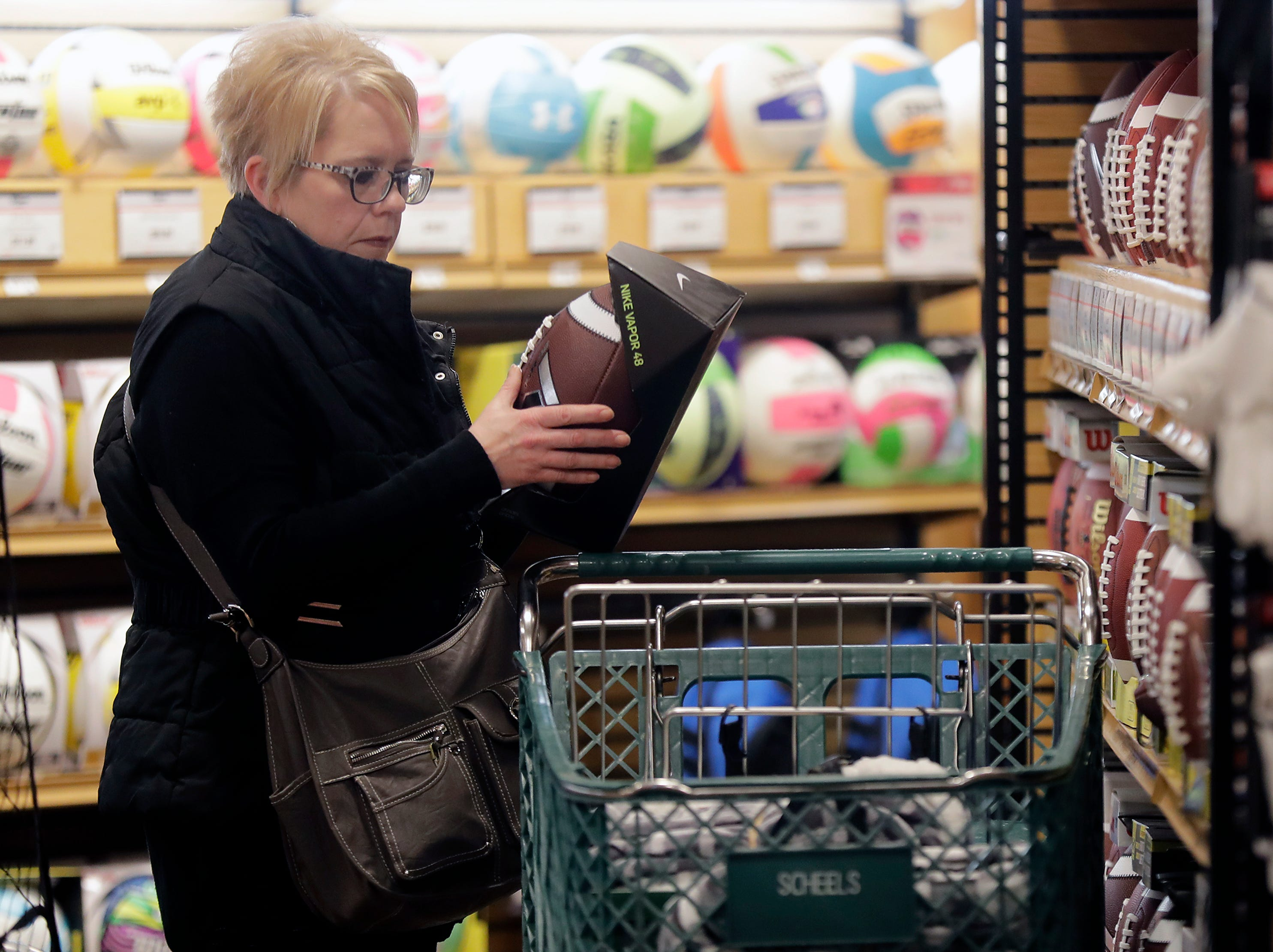 Julie Vandehey shops on Black Friday at Scheels on Friday, Nov. 23, 2018 in Grand Chute, Wis