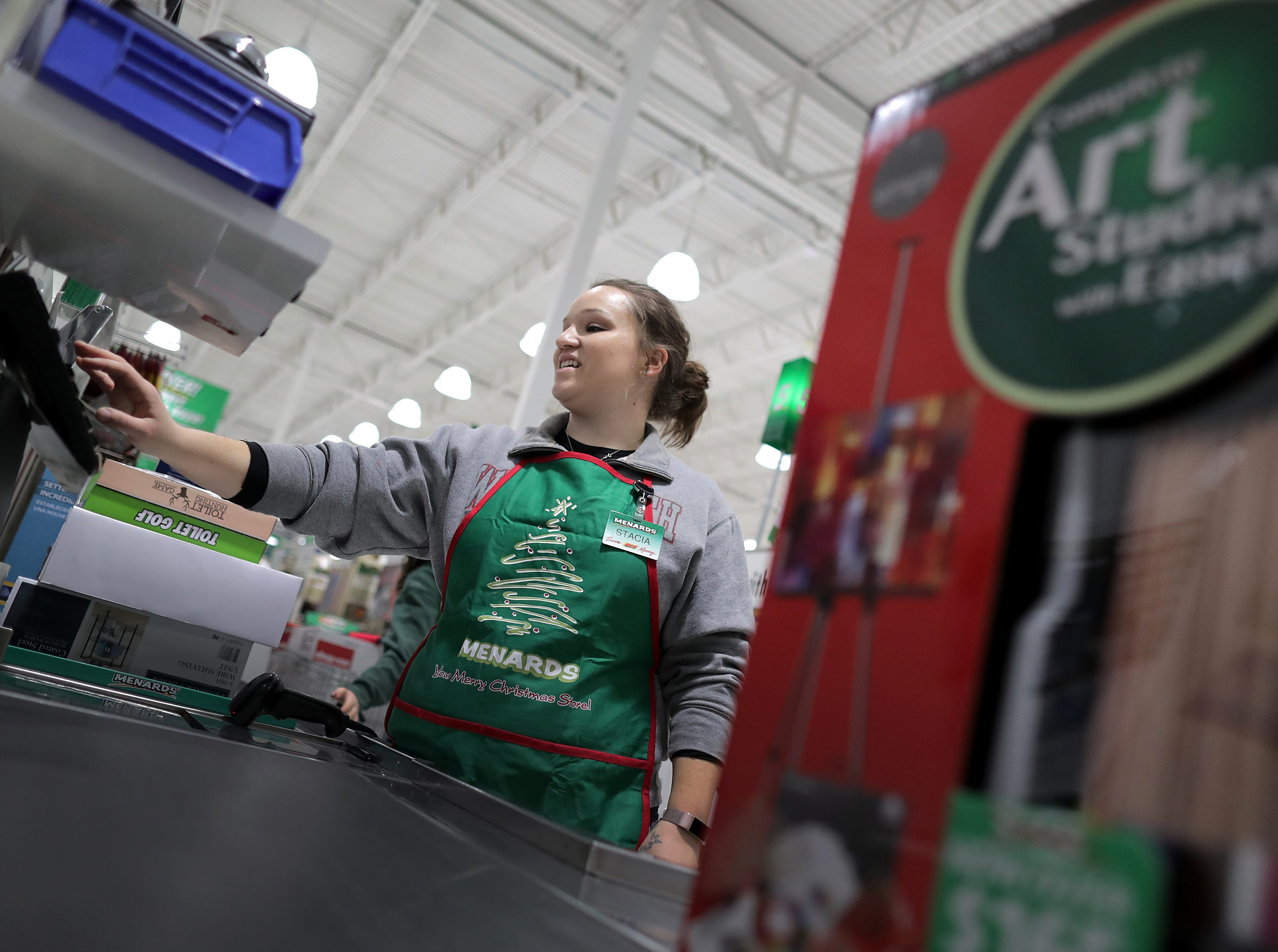 Stacia Vander Wielen works on a cash register during Black Friday at Menards on Friday, Nov. 23, 2018 in Grand Chute, Wis