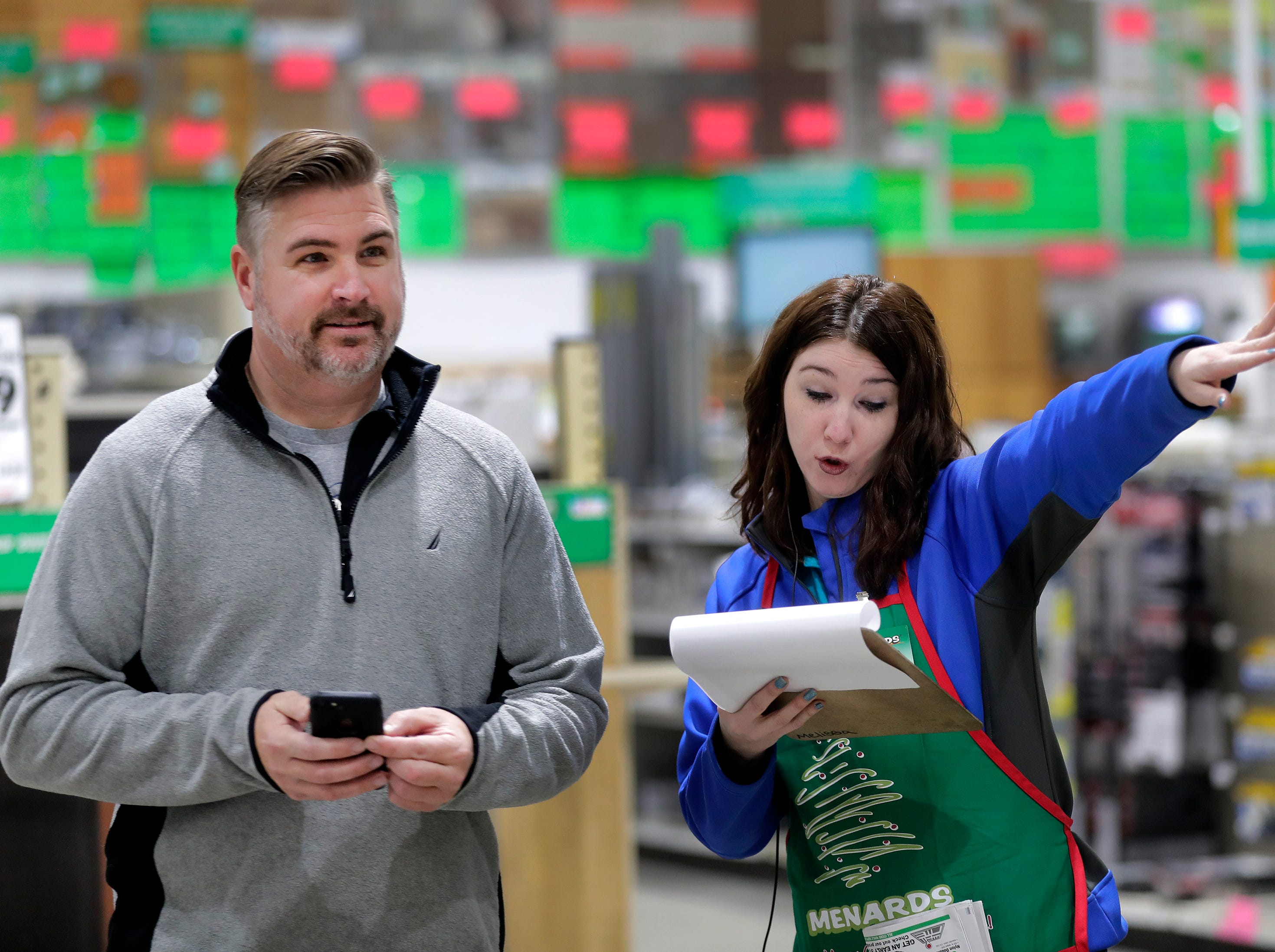 Melissa Scott helps Black Friday shopper Todd Wiunderlich at Menards on Friday, Nov. 23, 2018 in Grand Chute, Wis