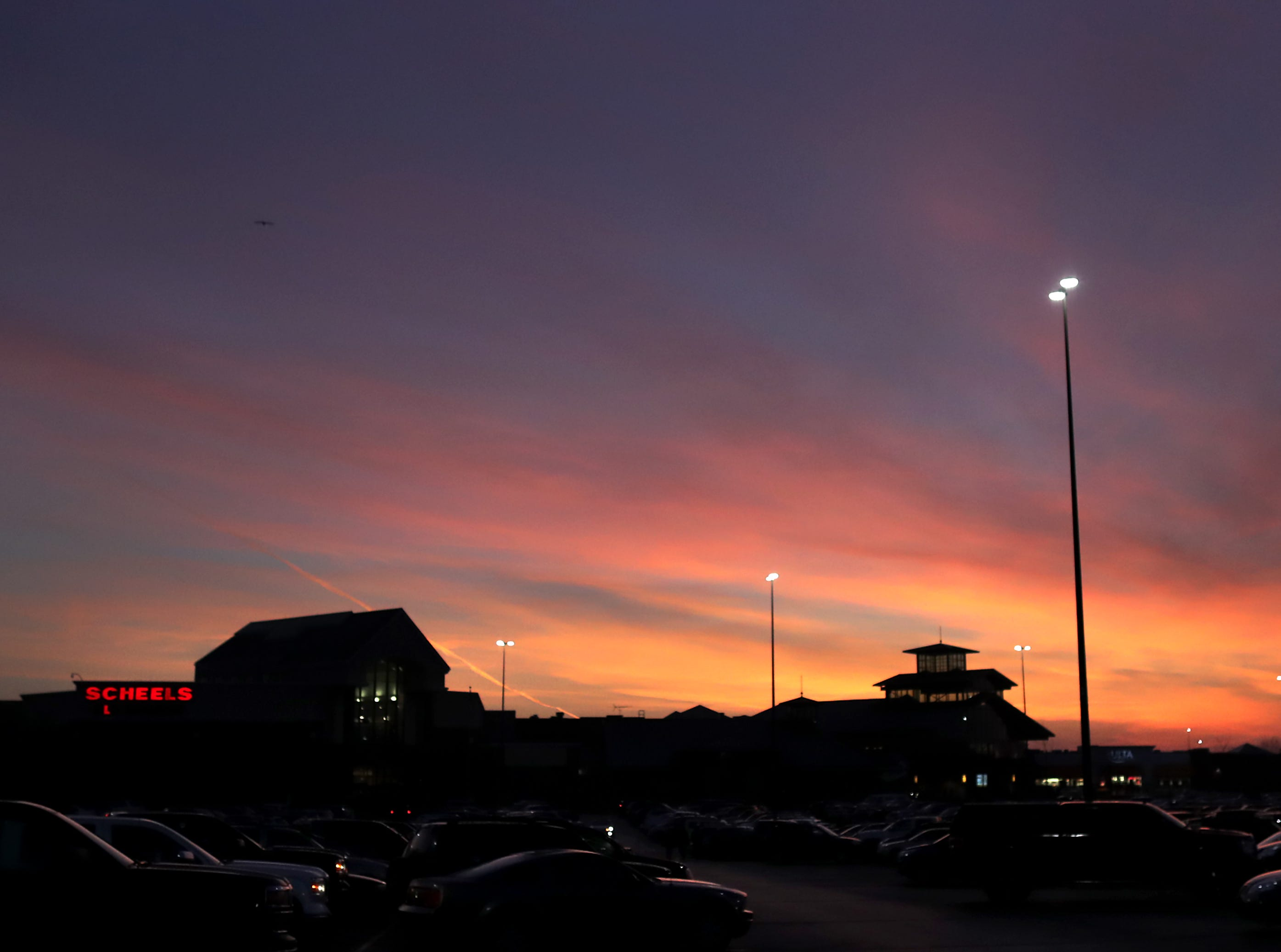 The sun rises over a full parking lot on Black Friday at the Fox River Mall on Friday, Nov. 23, 2018 in Grand Chute, Wis