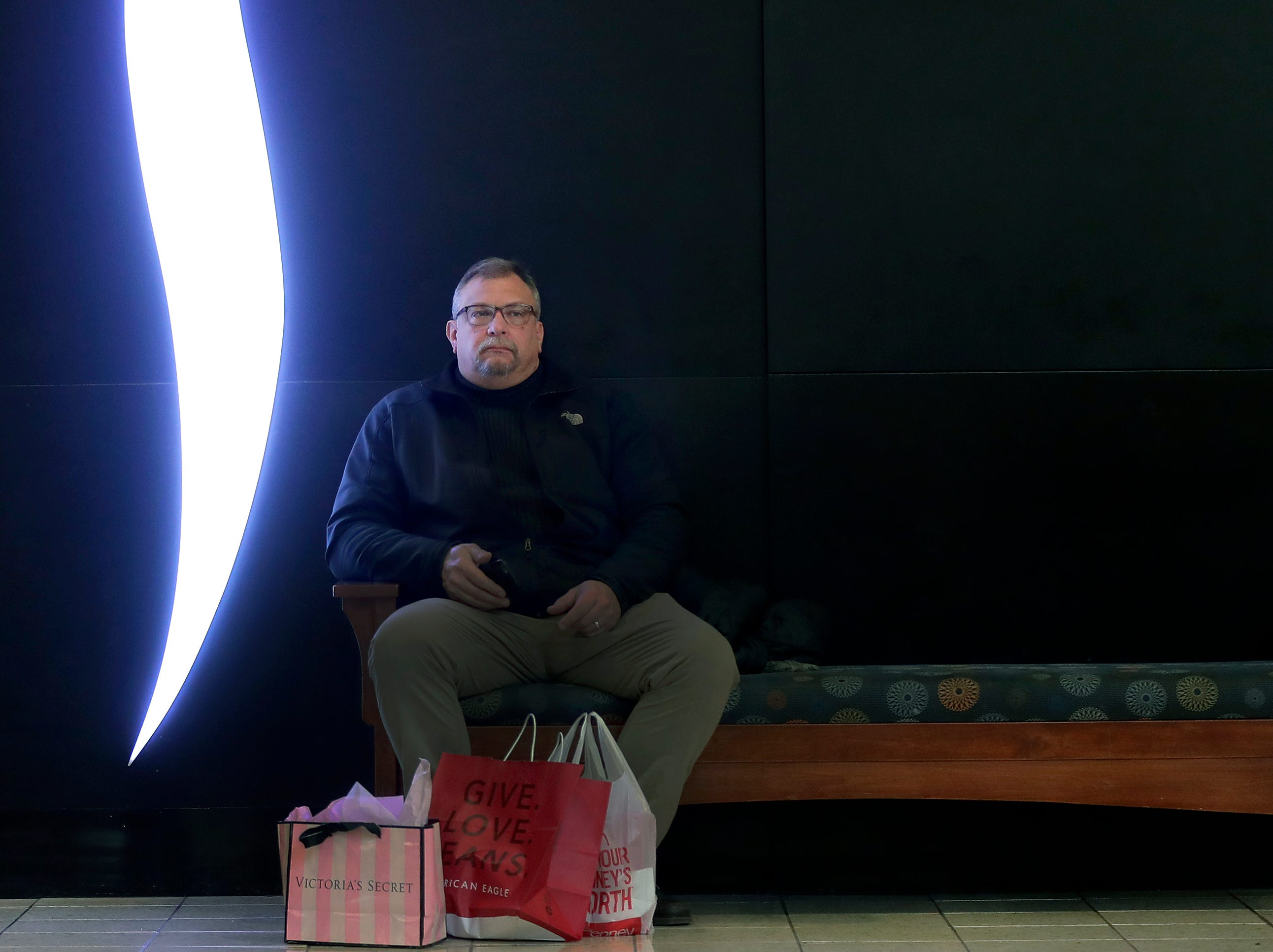 Tim Wiemer takes a break while shopping on Black Friday  at the Fox River Mall on Friday, Nov. 23, 2018 in Grand Chute, Wis