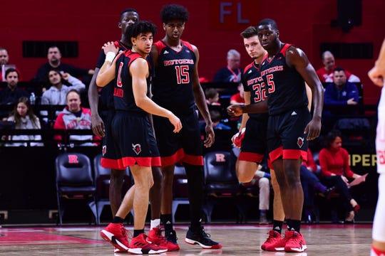 Rutgers' basketball players huddle up against Boston University.
