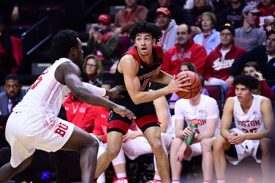 Rutgers' Geo Baker looks to pass against Boston University.