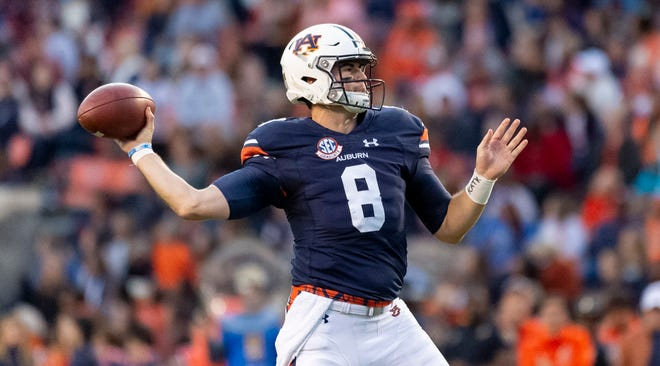 Auburn quarterback Jarrett Stidham (8) throws a touchdown pass against Liberty during the first half Saturday, Nov. 17, 2018, in Auburn, Ala.