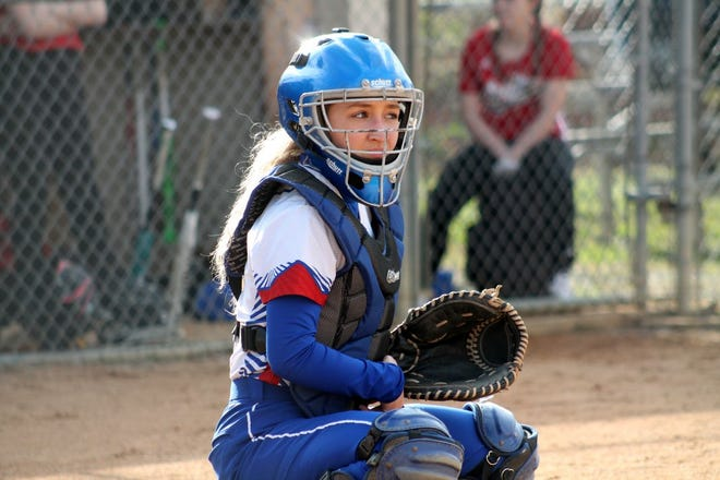 Bailey Cantrell squats into a catcher position.