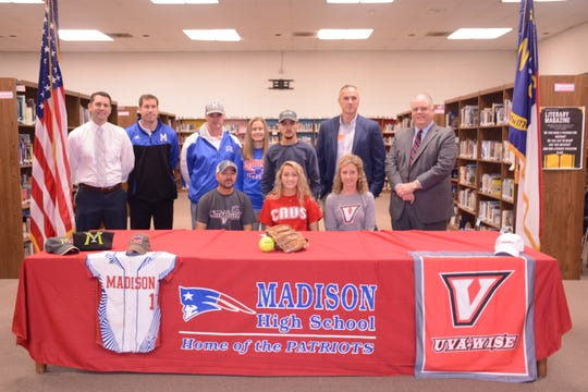 Bailey Cantrell with her parents, brother and coaches around her.