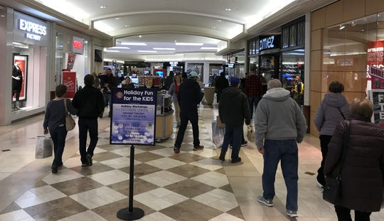 Shoppers at Oakdale Mall search for Black Friday bargains.