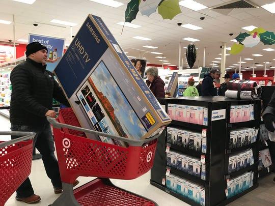 Black Friday shoppers grab bargains at Target in Vestal on Friday evening.