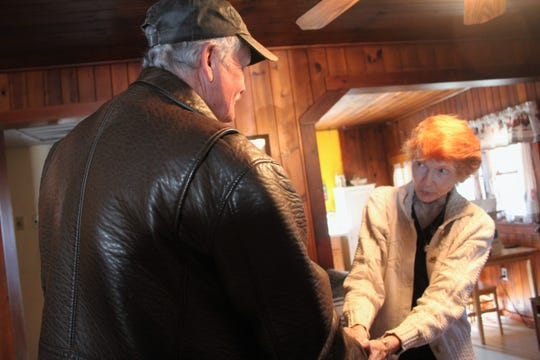 Black Mountain resident Mary Fender thanks mayor Don Collins for being one of five people from the town to deliver food to her for Thanksgiving.