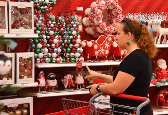 In a file photo, Diane Frederick shops for Christmas decorations at the Viera Super Target on Black Friday.