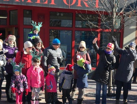 Crowds huddle together on a cold afternoon to watch Burlington's Santa Parade, Nov. 23, 2018.
