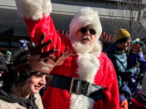 Vermont: Santa stops on Church Street in Burlington to greet onlookers.