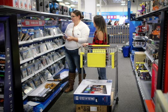 Black Friday shoppers look at movies inside the Best Buy in Corpus Christi.