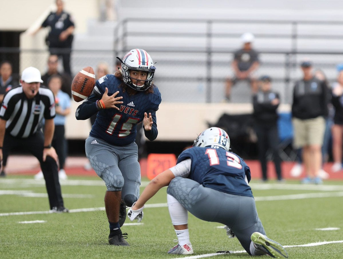 A blocked punt is recovered in the end zone for a Veterans Memorial touchdown, the extra point is no good in the Veterans Memorial game against San Antonio Harlan at Buc Stadium.