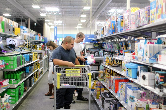Shoppers look at items inside Best Buy in Corpus Christi on Black Friday.