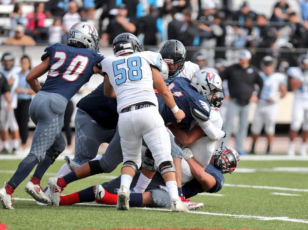 Eagles defense prevents a score in the Veterans Memorial game against San Antonio Harlan at Buc Stadium.