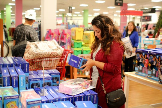 Andrea Battig looks at toys in JCPenney on Black Friday.