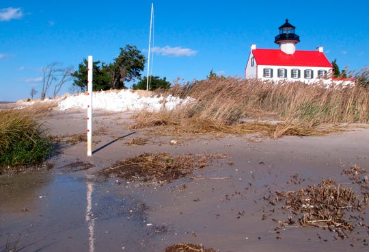 The Delaware Bay approaches the East Point Lighthouse in Maurice River Township.