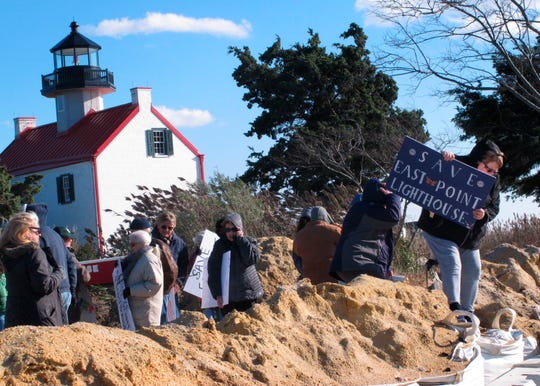 """Volunteers hold a """"Save The Lighthouse"""" rally near the East Point Lighthouse in Maurice River Township on Nov. 10."""