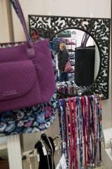 Bryla Elder peruses the handbags available at Ivy's Home & Garden the Friday after Thanksgiving in Downtown Chillicothe, Ohio.