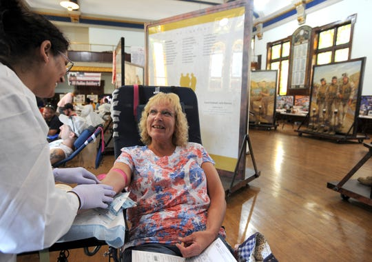 Pam Zeisler laughs while talking with phlebotomist Gail Mays during a Red Cross blood drive in Chillicothe in 2015. Red Cross volunteers are still in demand to help ensure blood drives operate efficiently, to train for disaster relief functions and assist in a number of other tasks.