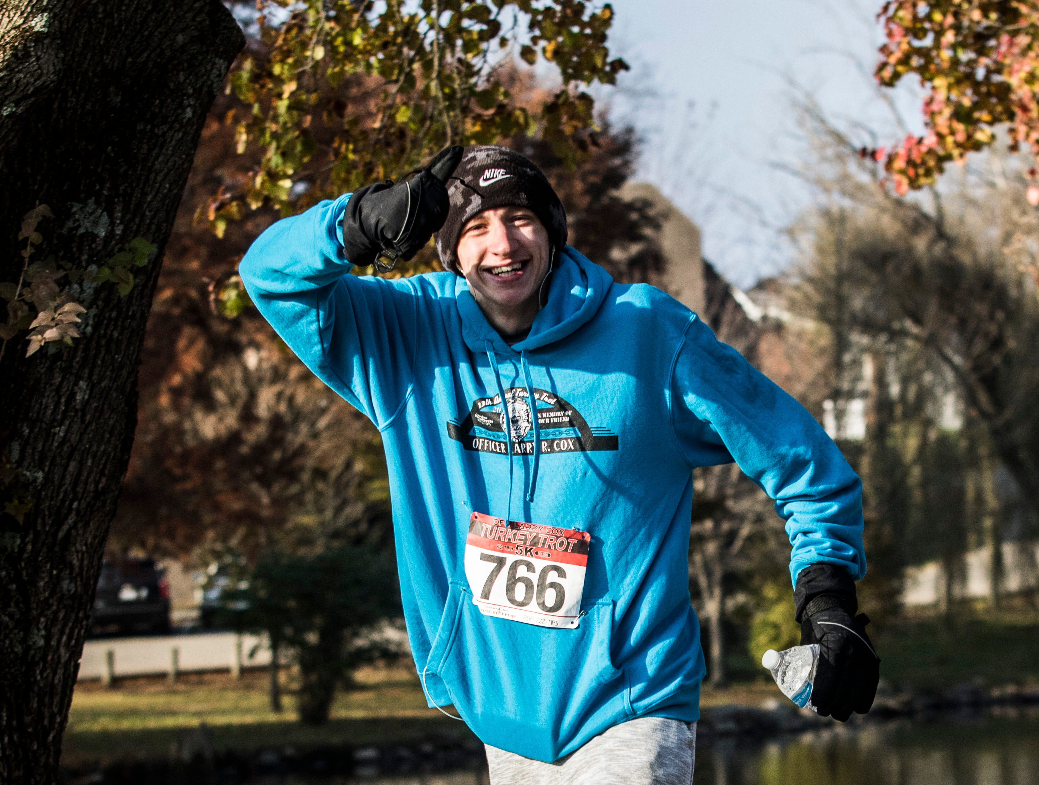 Area runners braved the cold Thursday morning to run in the 14th annual Larry Cox Turkey Trot on November 22, 2018 in Chillicothe, Ohio. Seth Farmer won the overall and men's division with a time of 15:43 and Brooke Smith won the women's division with a time of 17:58.