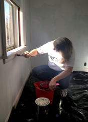 Robin Skeens paints a windowsill at The Assistance House in 2013 as part of a United Way Community Care Day project. The Assistance House currently has volunteer opportunities available answering phones, cleaning, shoveling snow when needed and scanning documents.