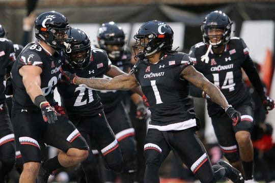 Cincinnati Bearcats wide receiver Kahlil Lewis (1) celebrates a touchdown in the second quarter of an NCAA college football game against the East Carolina Pirates, Friday, Nov. 23, 2018, at Nippert Stadium in Cincinnati.