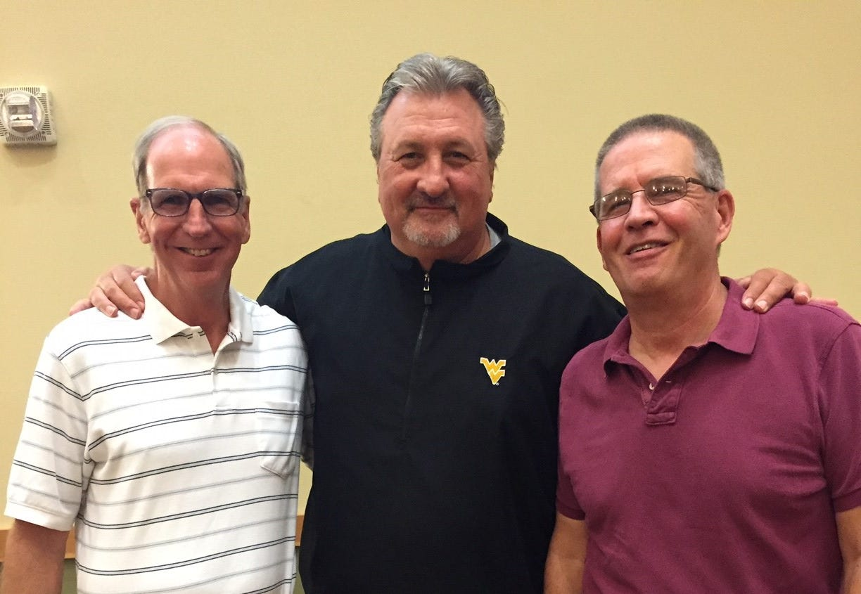 Bill Koch,left, former UC Bearcats coach Bob Huggins, center, and Tom Groeschen, right, at the reunion for the Bearcats' 1992 Final Four team.