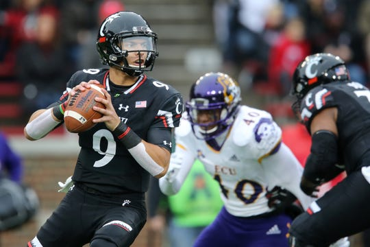Cincinnati Bearcats quarterback Desmond Ridder (9) drops back to pass in the first quarter of an NCAA college football game against the East Carolina Pirates, Friday, Nov. 23, 2018, at Nippert Stadium in Cincinnati.