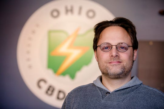 Jason Friedman, owner of Ohio CBD Guy, stands inside his new location in Covington, Ky., on Wednesday, Nov. 21, 2018.