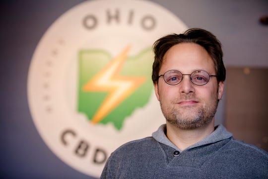 Jason Friedman, owner of Ohio CBD Guy, stands inside his new location in Covington, Ky., on Wednesday, Nov. 21, 2018.