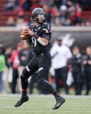 Cincinnati Bearcats quarterback Desmond Ridder (9) drops back to pass in the first quarter of an NCAA college football game, Friday, Nov. 23, 2018, at Nippert Stadium in Cincinnati