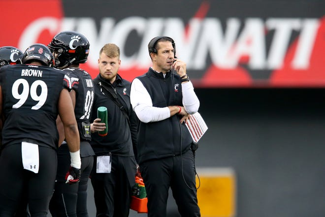 Cincinnati Bearcats head coach Luke Fickell talks into the headset during a timeout in the second quarter of an NCAA college football game against the East Carolina Pirates, Friday, Nov. 23, 2018, at Nippert Stadium in Cincinnati
