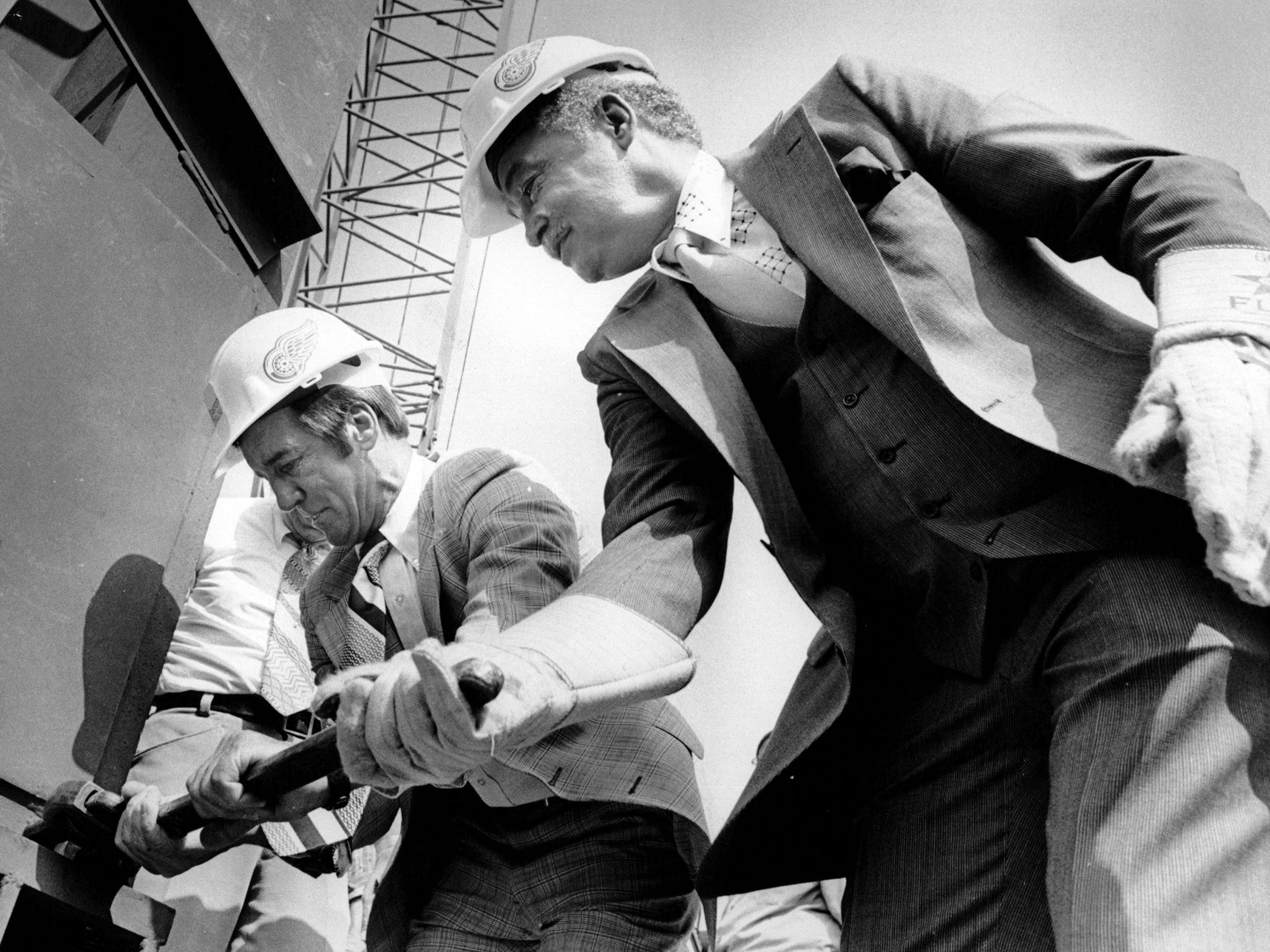 Ted Lindsay from the Red Wings and Coleman Young, Mayor of Detroit, turn a nut that secures a 21 ton column that will support roof girders at Joe Louis Arena in Detroit in August 1978.