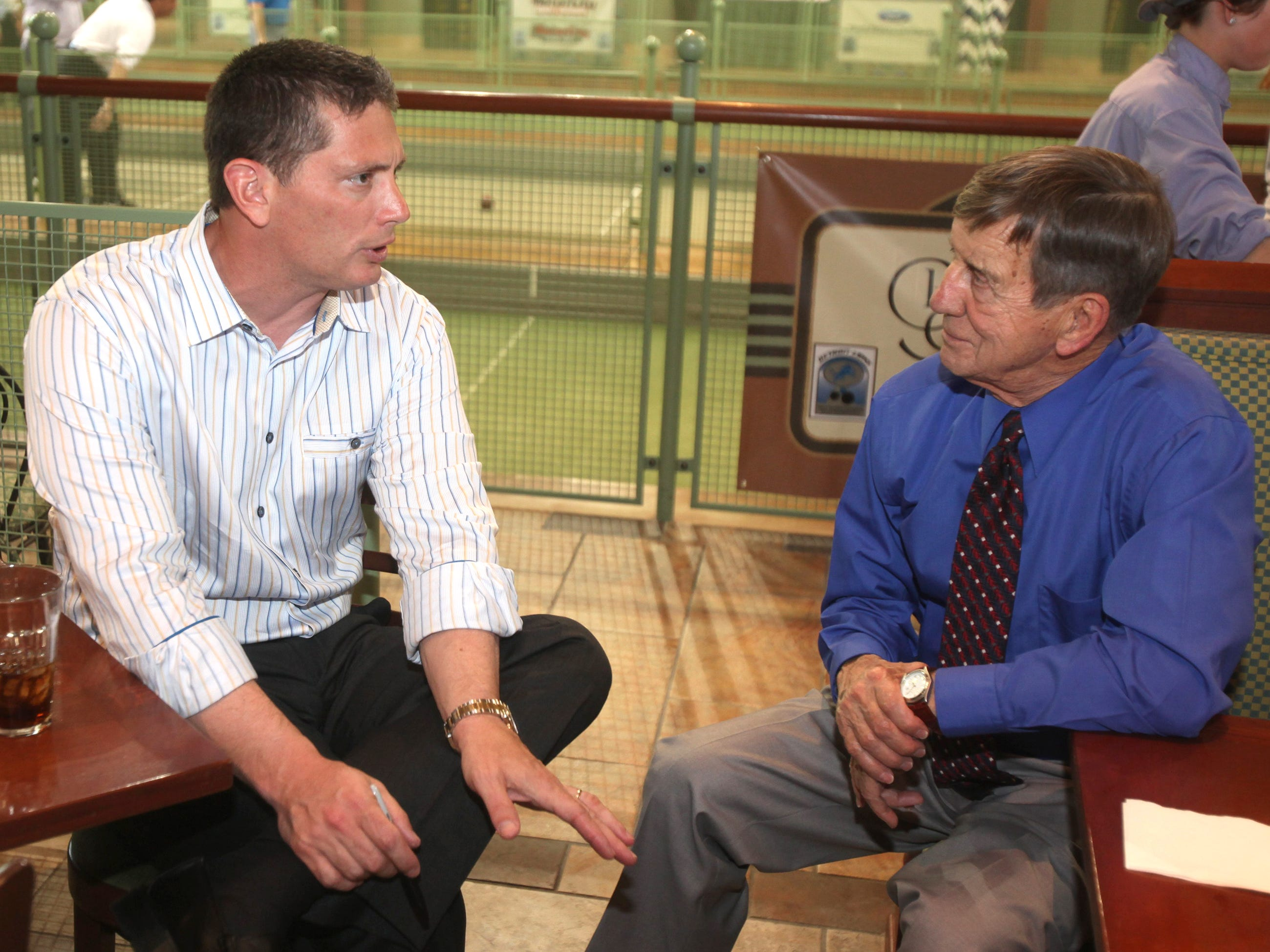 Detroit Lion head coach Jim Schwartz talked with hockey great Ted Lindsay at the the Memorial Tony Filippis Bocce Tournament held at Palazzo di Bocce in Orion Township Tuesday, May 18, 2010.