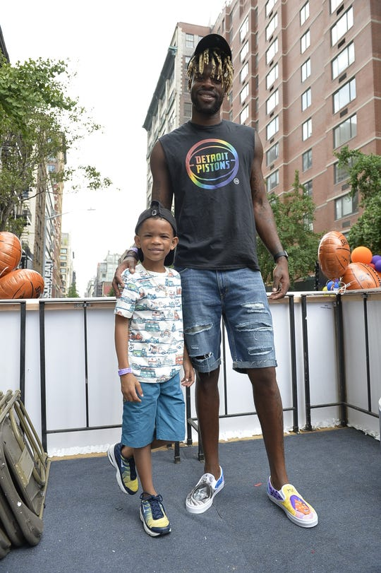 Detroit Pistons forward Reggie Bullock with his son, Treyson, during June's New York City LGBT Pride March.