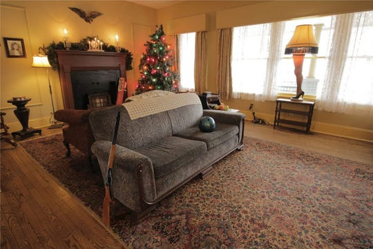 The famous leg lamp illuminates the window of the Christmas Story House & Museum.