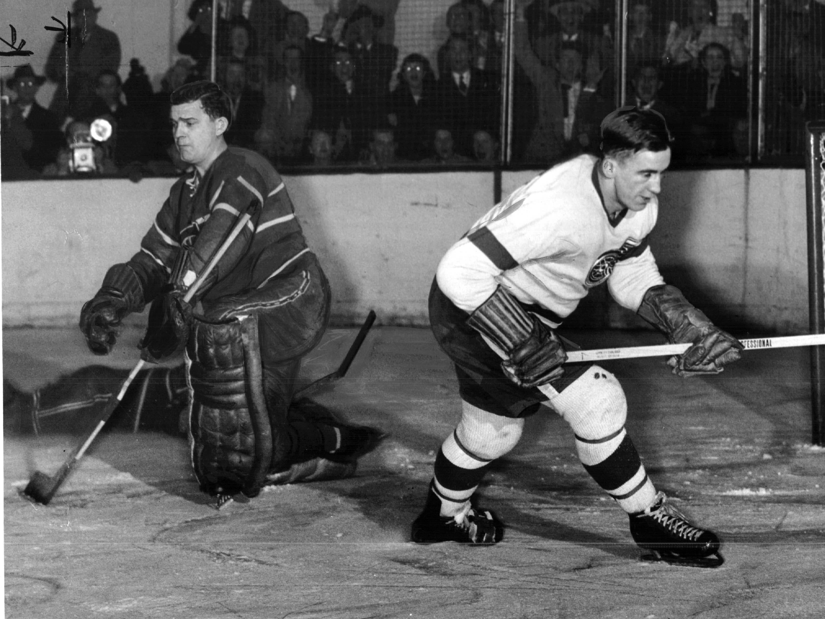 Red Wings Ted Lindsay nonchalantly skates past the net as the puck heads for open net, date unknown.